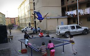 Kids From A Poor Part Of Johannesburg Receive A Trampoline And Soar Through The Air With Glee