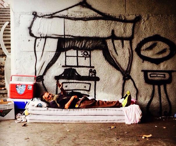 http://www.boredpanda.com/blog/wp-content/uploads/2014/10/homeless-man-art-interactive-4.jpg