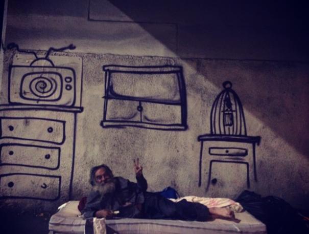 http://www.boredpanda.com/blog/wp-content/uploads/2014/10/homeless-man-art-interactive-5-605x457.jpg