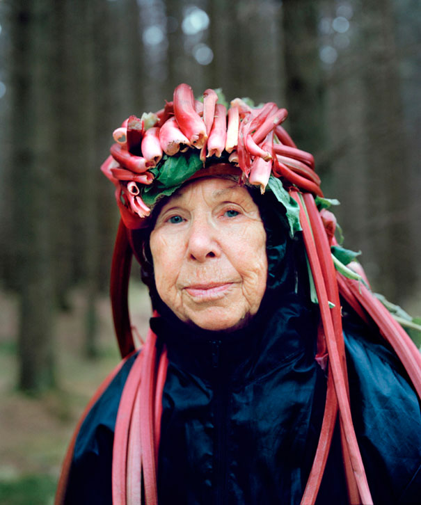 Seniors Wearing Odd Headgear Made From Flora