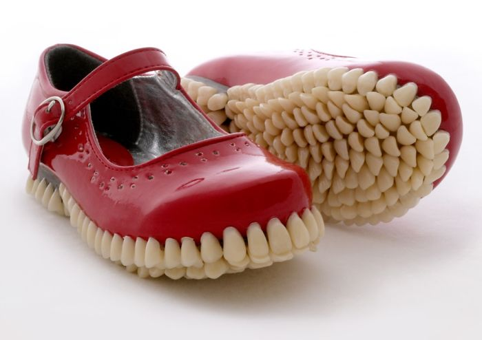 Bizarre Shoe Sculptures With Hundreds Of Artificial Teeth On Their Soles