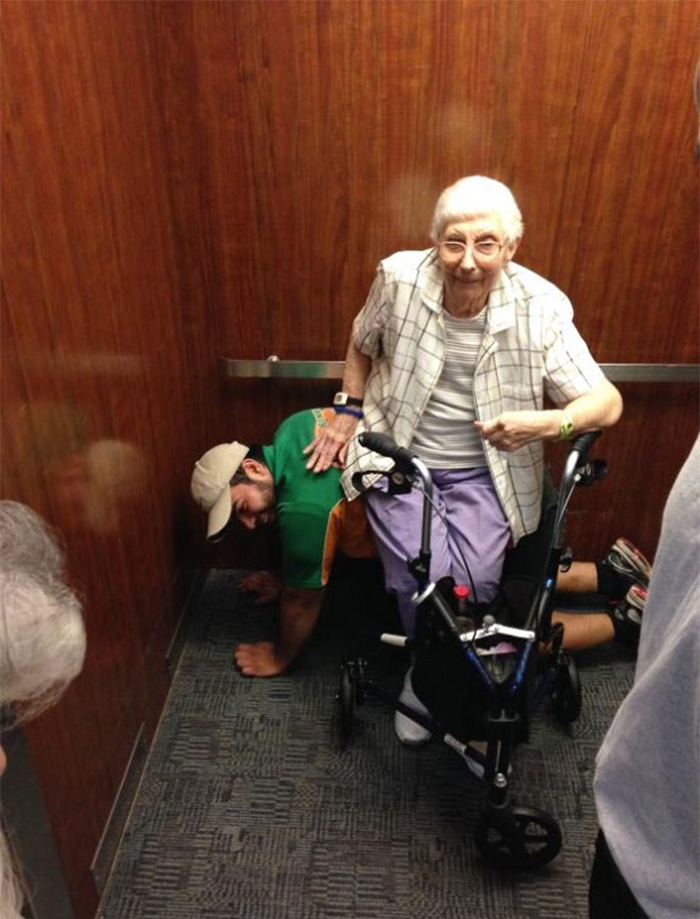 Chivalry's Not Dead! Man Serves As Bench For Elderly Woman Stranded In Elevator