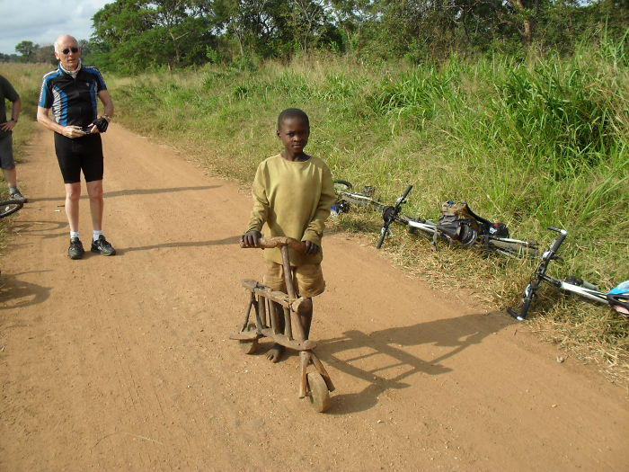 Tanzania, A Young Boy Proudly Shows Us His Bike