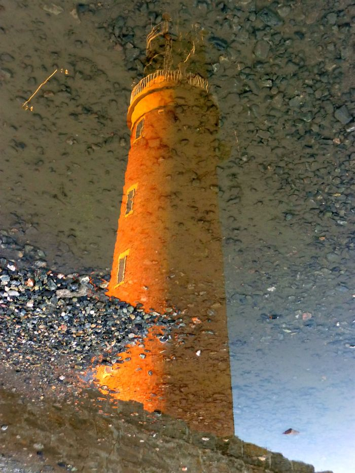 Guiding Light Reflected In A Puddle, Isle Of Lewis, Outer Hebrides