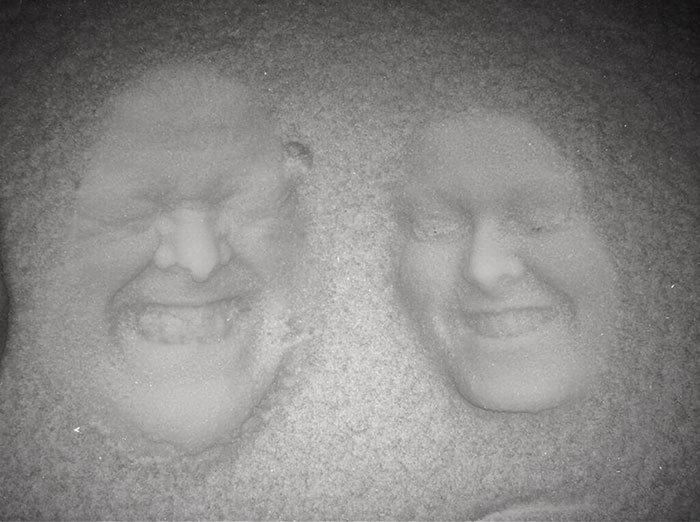 Forget Snow Angels – Father And Daughter Create 3D Images By Pressing Their Faces Into The Snow