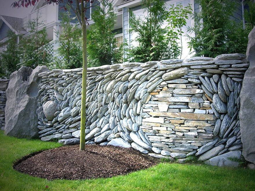 The ancient art of stone couple creates beautiful rock for Stone wall art