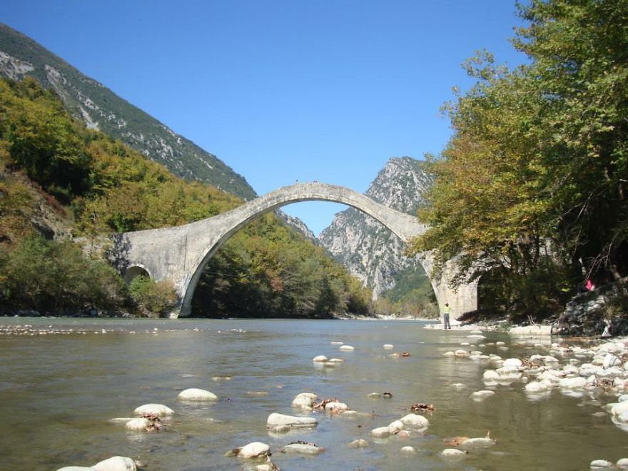 Plaka Bridge On Arahthos River, Pindos Mountain, Greece.