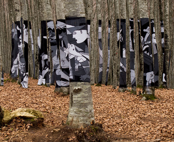 """Picasso's """"guernica In The Woods"""", With Bio Paint In Protest Plans To Destroy The Forest. Spain"""
