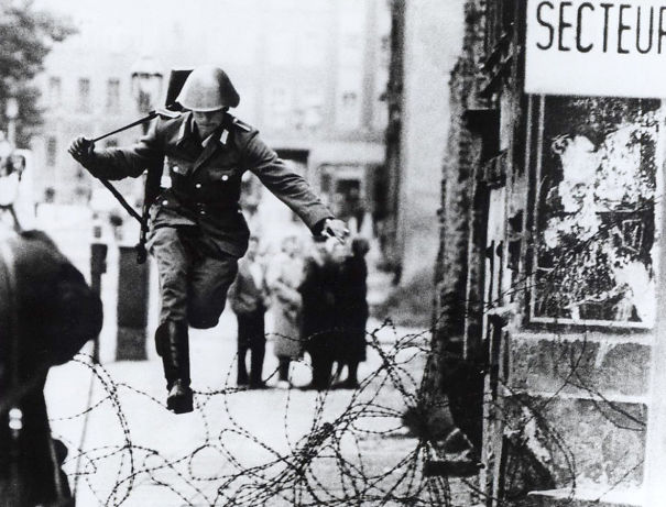 East German Soldier Jumping Barbed-wire Fence 1961