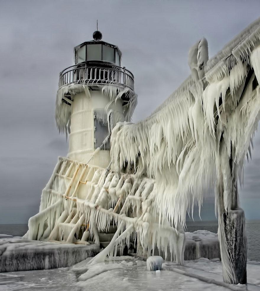 Frozen Lighthouses On Lake Michigan Shore