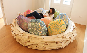 Giant Birdnest: Wooden Bed Filled With Soft Egg-Shaped Pillows