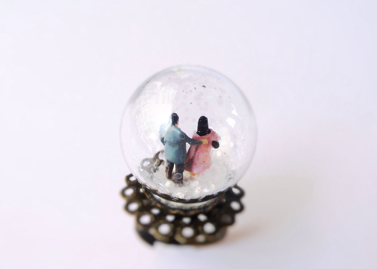 People Walking While Snowing Ring