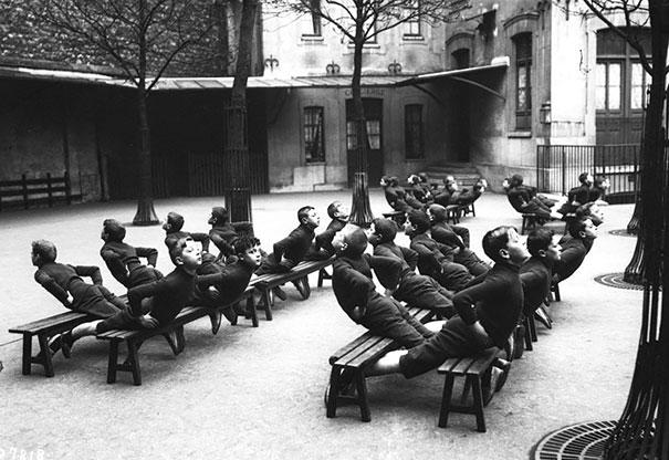 Children Exercising In A School-yard, 1900
