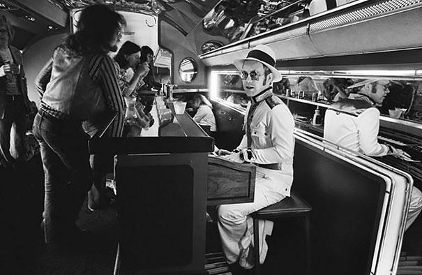 Elton John At The Piano Bar Aboard His Private Plane, 1976