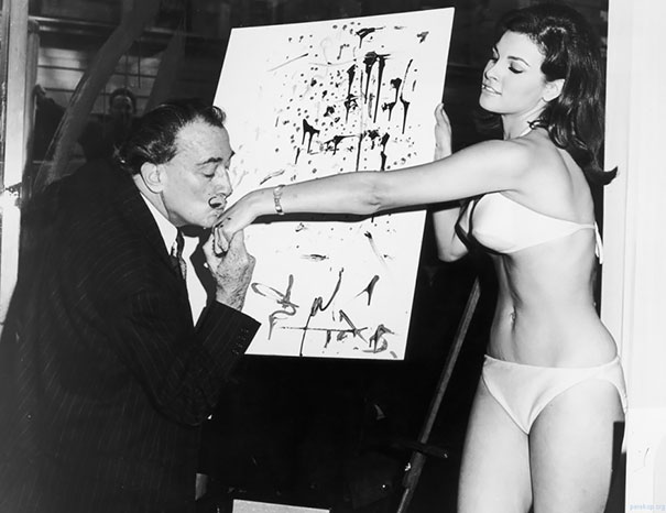Salvador Dali Kisses The Hand Of Raquel Welch After Finishing His Famous Portrait Of Her, 1965