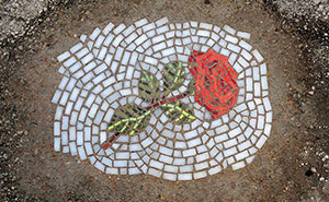 Guerrilla Artist Fills Chicago Potholes With Flower Mosaics