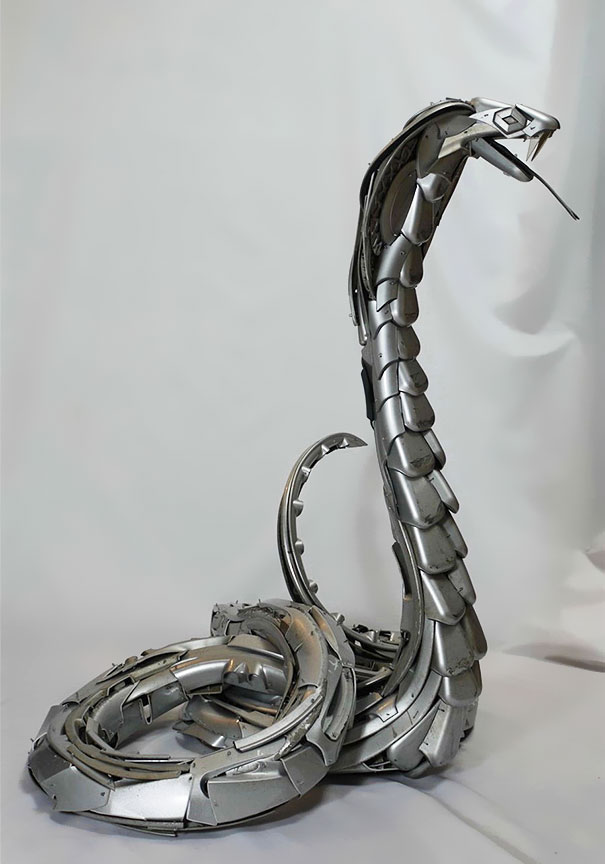 Artist Recycles Old Hubcaps Into Stunning Animal