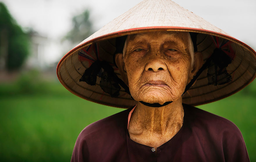 Rice Farmer In Small Vietnamese Village