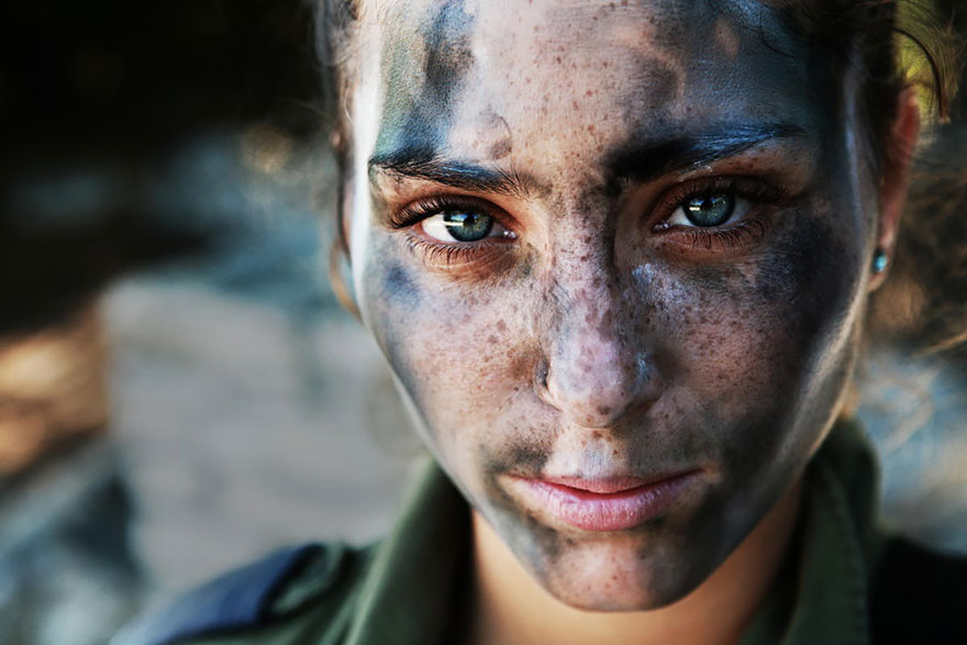 An 18 Year Old IDF Soldier Pauses After A Long Run In Full Gear And Battle Paint