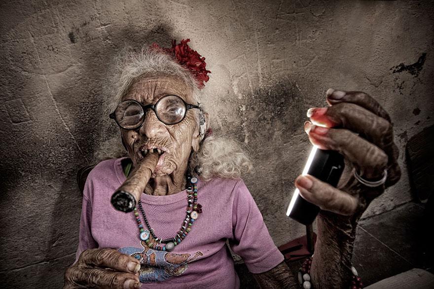 Cuban Woman Smoking A Cigar And Holding A Ring Flash