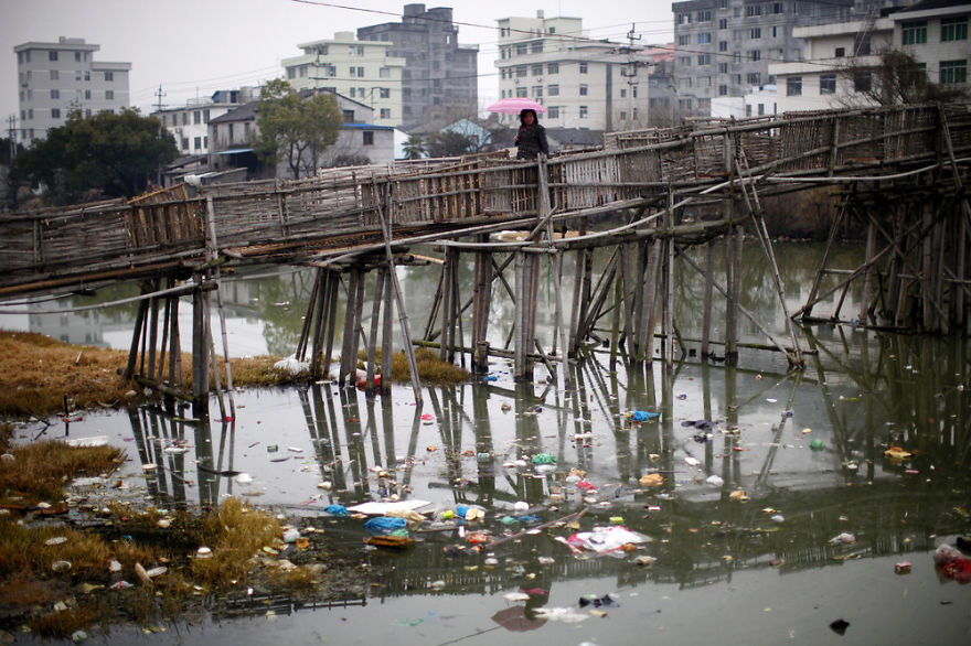 Woman Walks On Bridge Over Polluted River, Wenzhou, Zhejiang Province