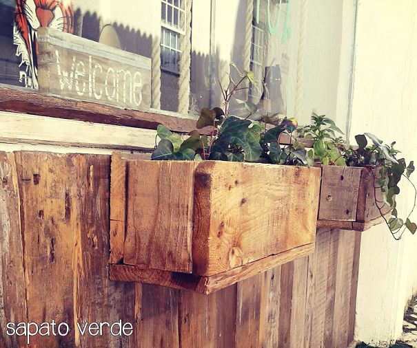 Flower Vase And Wall Made With Old Wood. Vegan Store In Cascais, Portugal