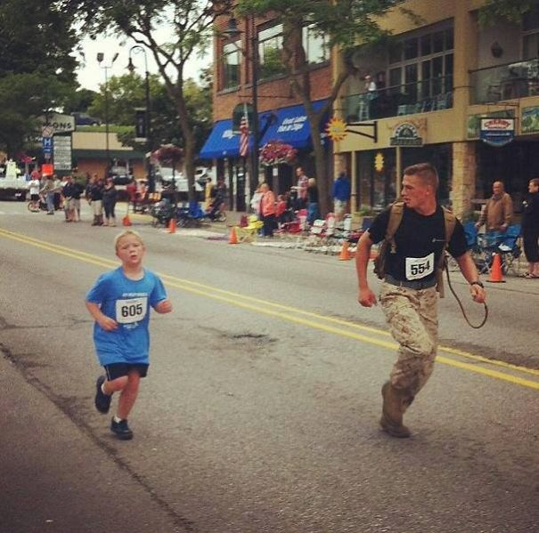 Marine Myles Kerr Finishes A Race Last To Help A Young Boy Who Got Separated From His Group