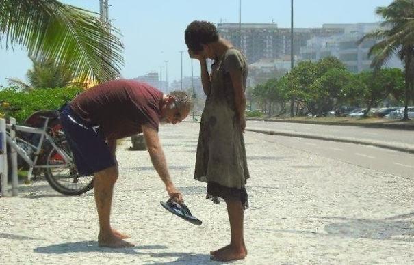 A Man Gives His Shoes To A Homeless Girl In Rio De Janeiro