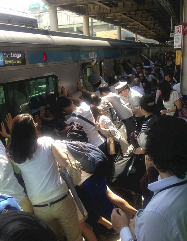 Dozens Of Japanese Train Passengers Pushed 32-Ton Train Car Away From Platform To Free Woman Trapped In Gap