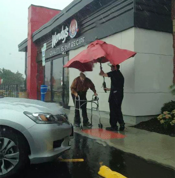 Wendy's Employee Removes Umbrella From Table To Protect Elderly Man From Rain