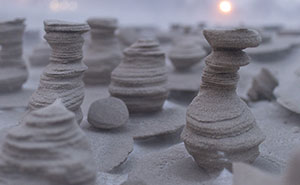 Wind Turns Frozen Sand Into Alien Towers On Lake Michigan Shore