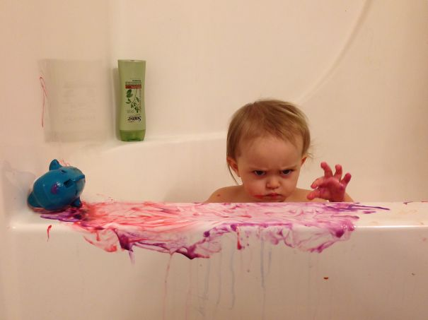 My Daughter Playing With A Toy Dolphin And Bath Paint