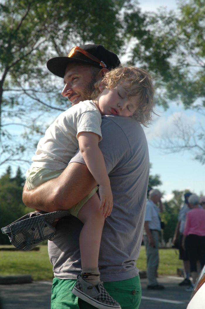 This Dad Carries His Napping Son Around While On Holidays.