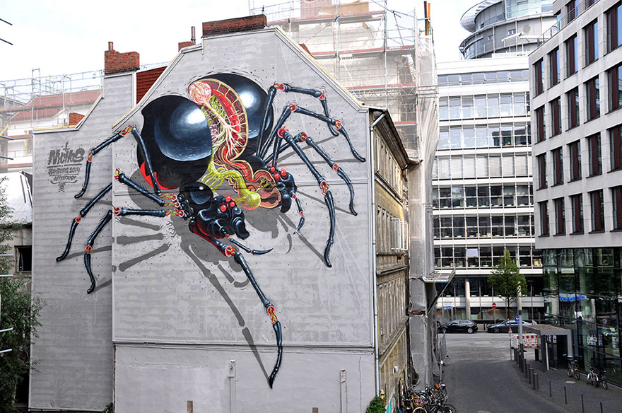 Street Art 'Surgeon' Cuts Open Cartoon Characters To ...