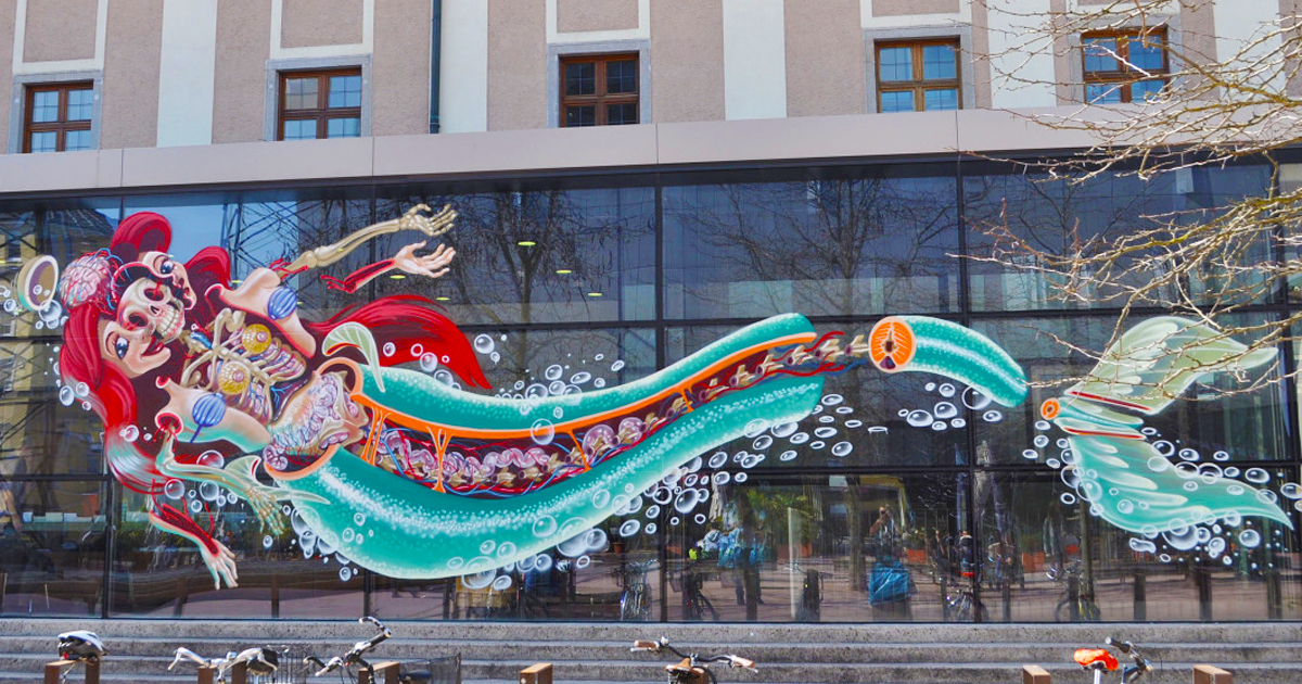 Street Art 'Surgeon' Cuts Open Cartoon Characters To Reveal Their Anatomy