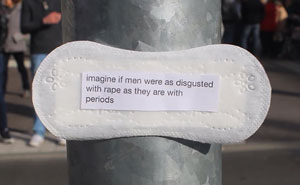 A Woman Is Posting Feminist Messages Written On Period Pads All Over Her City