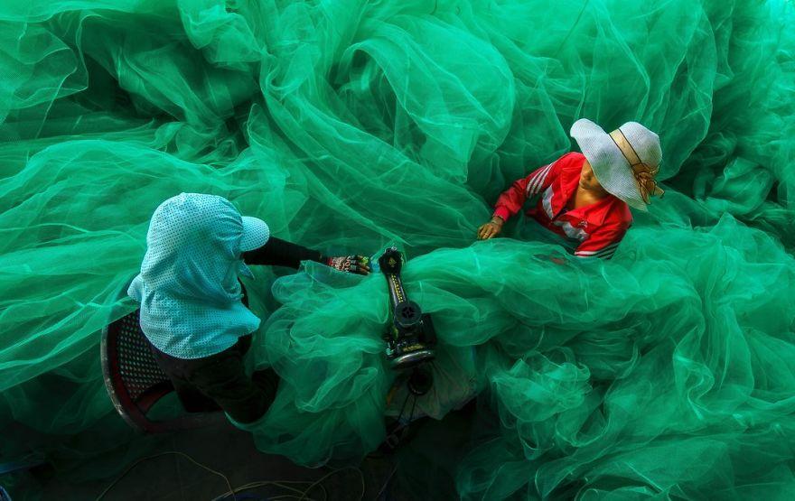 Women Of A Small Village Near Vinh Hy Bay, Vietnam, Sew A Fishing Net While Their Husbands Fish, Vinh Hy Bay, Ninh Thuan, Vietnam