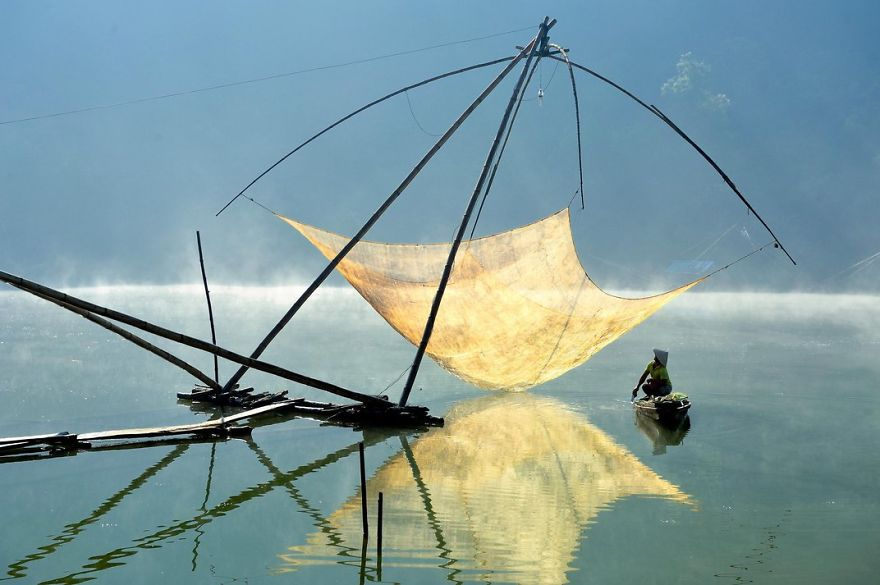 A Fisherman Checks His Net In The Early Morning, Lam Dong, Dalat, Vietnam