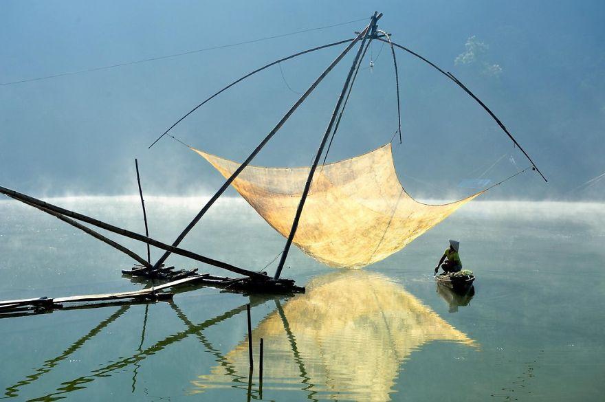 A Fisherman Checks His Net In The Early Morning, Lam Dong, Dalat, Vietnam