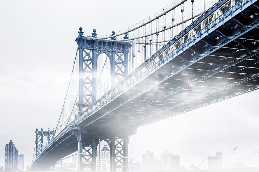 Fog Creeps Under The Manhattan Bridge, New York, New York