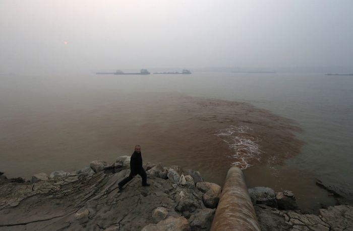 Man Walks Next To Polluted Water Supply; Beijing, China
