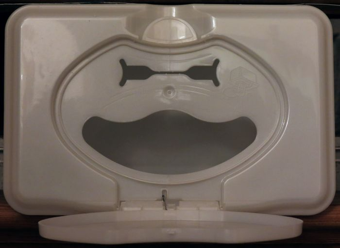 A Grinning Face (with A Little Hat) Found Under The Lid Of A Tub Of Baby Wipes