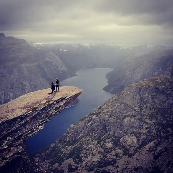 "Proposing On Trolltunga After A 9 -Hour-Long Hike. ""As I was looking at the camera Connor tugged my hand, when I turned around he was on one knee."""