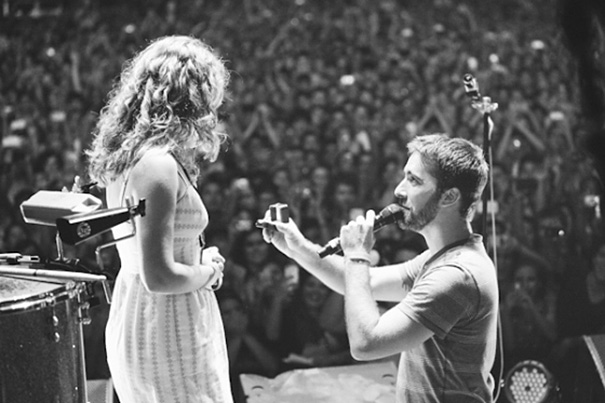 "Proposing On Stage During A Concert Of A Favorite Band. ""I was shaking and couldn't stop smiling. I listened while the man of my dreams knelt and proposed to me, echoed by the cheers of 7000 supporters."""