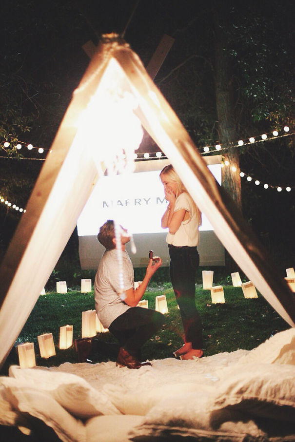 There were flower petals and candles everywhere and a movie screen set up. Aaron pressed play, came and sat by me in the teepee, and started shaking and tearing up.