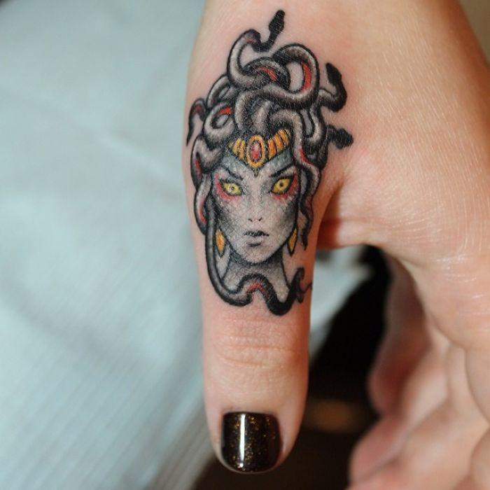 Medusa Finger Tattoo