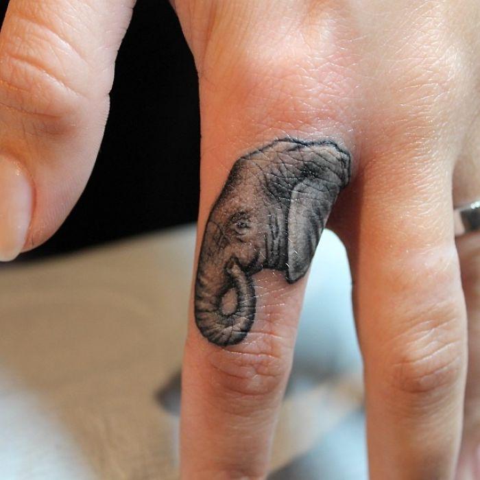 Elephant Finger Tattoo