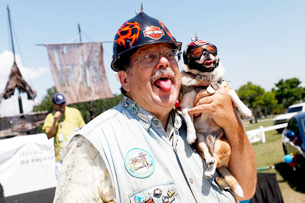 Owner Poses With His Dog During The Dog And Owner Look-Alike Contest
