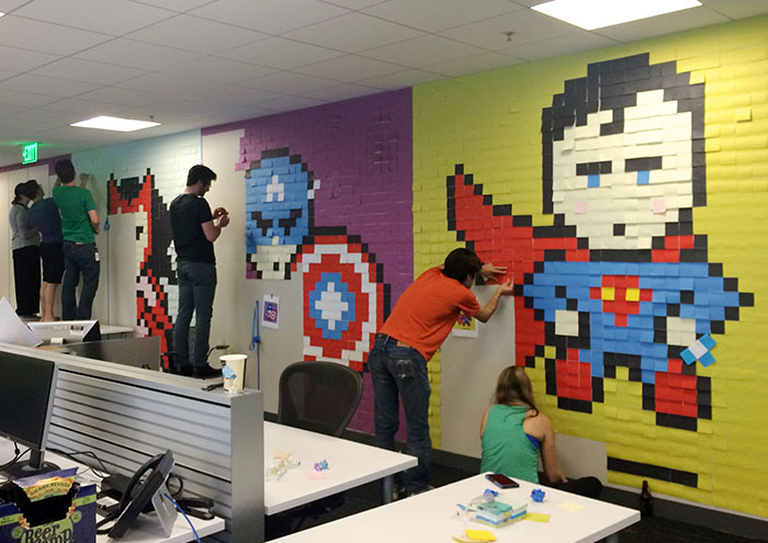 Worker Uses 8,024 Post-It Notes To Turn Boring Office Walls Into Superhero Murals