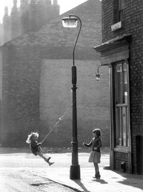 Two Girls Swing On A Lampost, Manchester, 1965